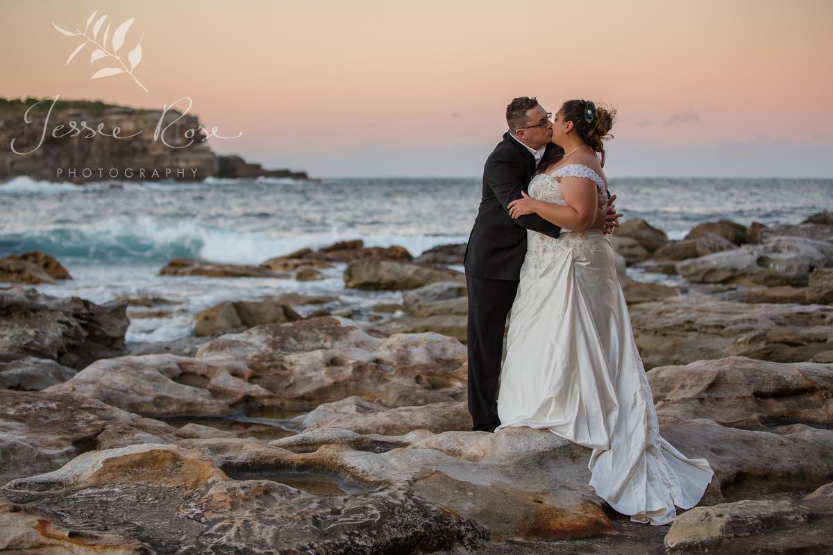 beach-sunset-wedding-kiss