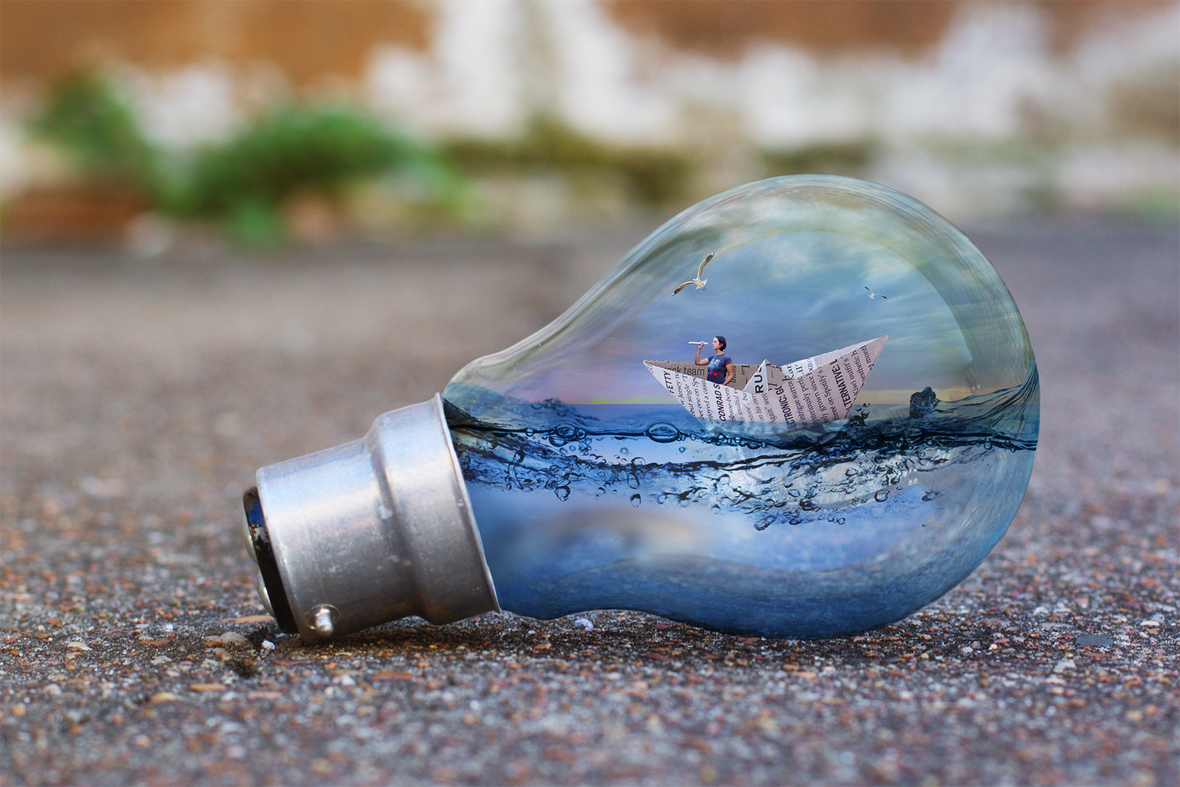 033-paper-boat-in-a-light-globe